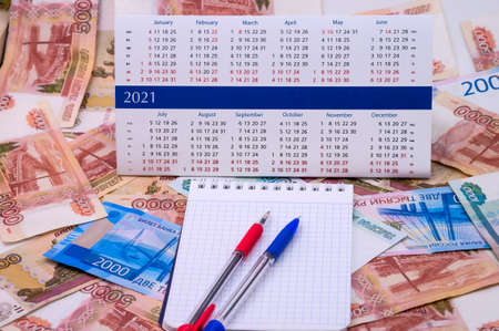budget planning, sales strategy for the next year, Notepad and money, calendar for 2021 Stock Photo