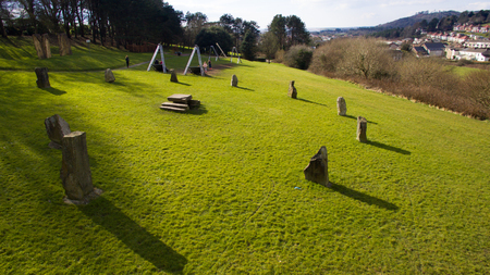 stone circle: An aerial image of a man made stone circle in a green field.