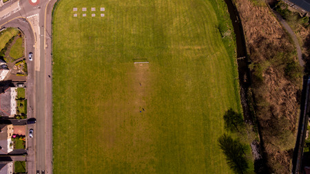 aerial photograph: An aerial photograph of a rural football fiels. The goalposts are visible towads the top of the frame.