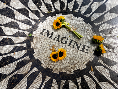 NEW, YORK USA - September 11, 2016: The Imagine mosaic with sunflowers at Strawberry Fields in Central Park, Manhattan Stock Photo