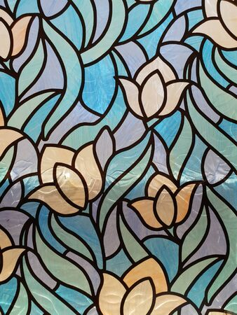 A stained glass style background or texture depicting flower shapes Banco de Imagens