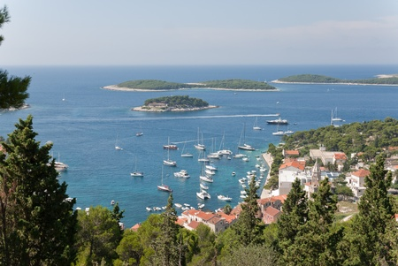 former yugoslavia: the harbor of the island hvar and some other small adriatic islands Stock Photo