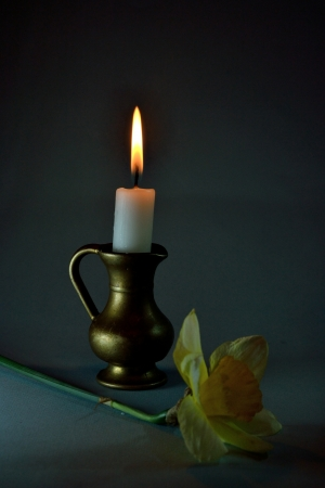 bronzy: candle in the  bronze candlestick Stock Photo