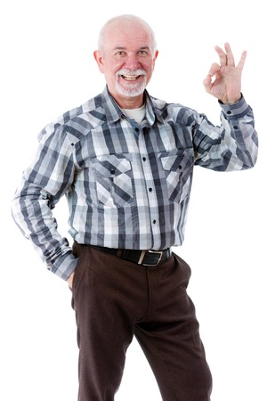 55 years old: Happy old man smiling with white teeth showing OK gesture. Isolation Stock Photo