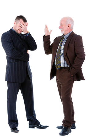 Senior and junior handsome business people discussing. Isolated photo