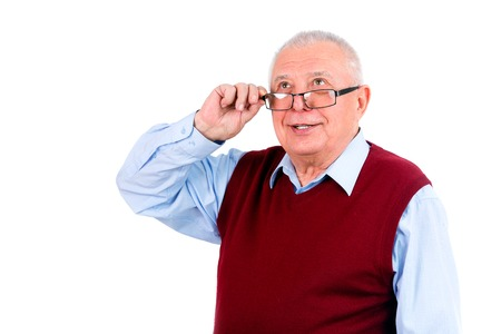 Smiling happy senior old man looking up and holds the glasses right hand, isolated on white background photo