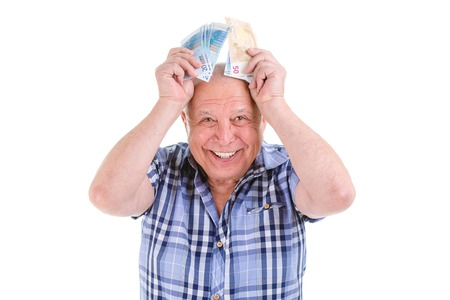 financial reward: Closeup portrait, happy, excited successful senior lucky elderly man holding money Euros banknotes in hand isolated white background. Positive emotion facial expression feeling. Financial reward savings