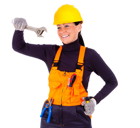 Beautiful young woman in hardhat wearing tool belt and holding wrench, hammer, pliers and screwdriver, Isolated on white background photo