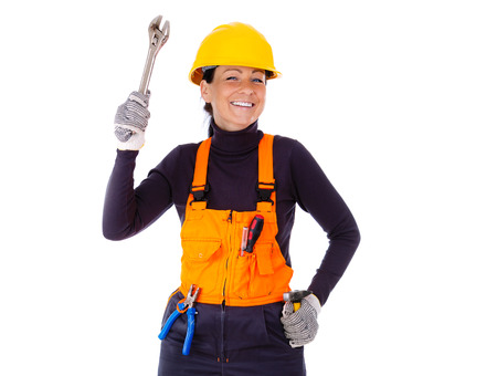 Beautiful young servicewoman in hardhat holding wrench, hammer, pliers and screwdriver, Isolated on white background photo