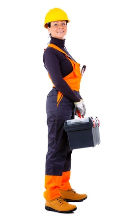 overall: Beautiful Service woman wearing yellow helmet and blue overall, holding black toolbox, Isolated on white background
