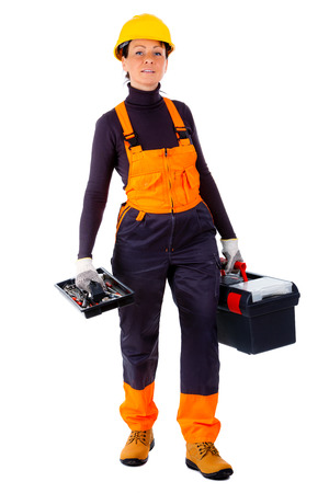 servicewoman: Servicewoman wearing yellow helmet and blue overall, holding black toolbox, Isolated on white background