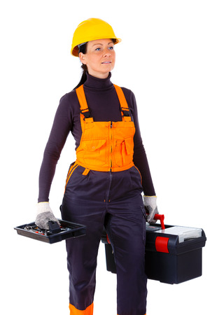 overall: Portret of Servicewoman in yellow helmet and blue overall, holding black toolbox, Isolated on white background