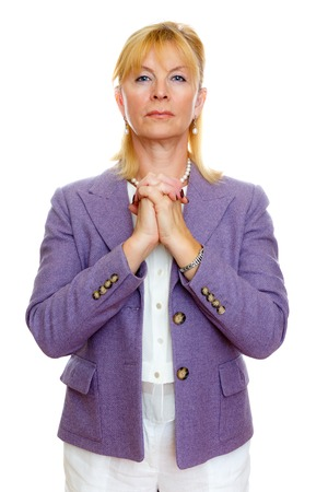 obliged: Closeup portrait of senior mature business woman 65-65 years with hands clasped very grateful and thankful looking at camera, isolated on white background. Positive human emotion, facial expression