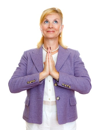 obliged: Happy old senior businesswoman 65-65 years with hands clasped praying while, looking at up, isolated on white background. Positive human emotion, facial expression