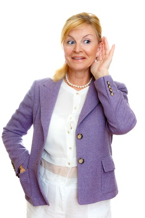 gesticulate: Elderly woman old senior 60-65 years woman with hardness of hearing listening, white teeth, in suit with big blue eyes, isolated on white background, Positive human emotion, facial expression