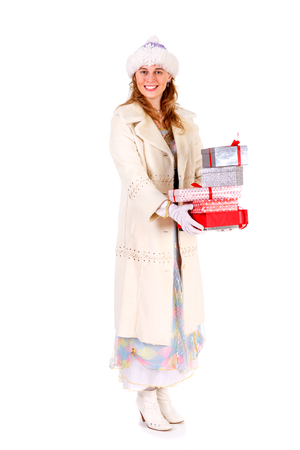 boxs: christmas, winter, holidays - Smiling snow maiden holding christmas gifts with many boxs on both hands. Isolated white background Stock Photo