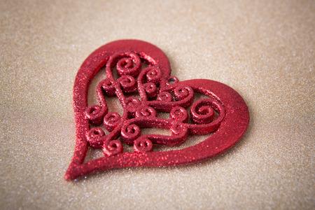 glistening: Valentines Day background - red heart on gold glistening background