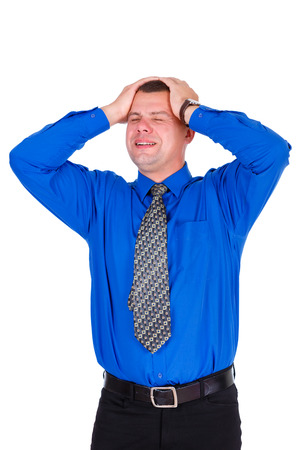 weary: Weary and upset businessman with eyes closed in jeans, blue shirt and tie. Keep his hands on head. Isolated white background. negative emotions