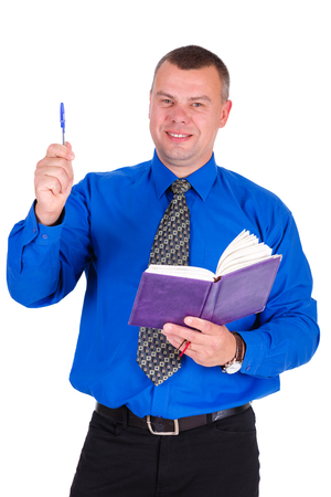 smiled: Happy and smile businessman in jeans, blue shirt, tie Holding notebook and pen in different hands. Isolated white background. Concept of leadership and success Stock Photo