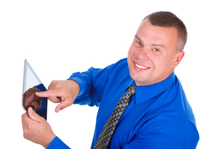 ibook: Closeup portrait Smiling businessman in blue shirt and tie. Using digital tablet pc computer reading ebook and looking to camera, Isolated white background, Concept of leadership and success