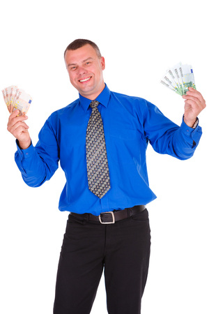 free me: Full length portrait of happy, smile, successful, lucky businessman in blue shirt and tie. Holding money euros banknotes with hands up. Isolated white background. Positive emotion