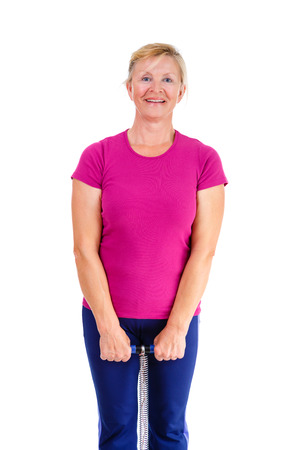 65 years old: Happy and white teeth smile old senior woman in sport outfit marsala color doing fitness exercises, isolated on white background, Positive human emotions