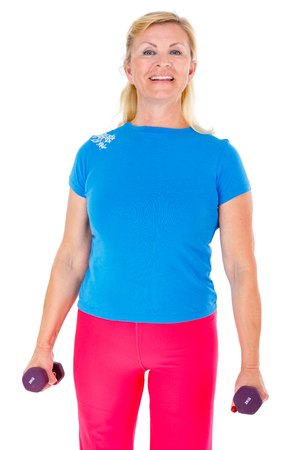 65 years old: Happy and smile old senior woman in sport outfit doing fitness exercises with weights, isolated on white background, Positive human emotions
