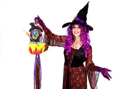 Young lady dressed in Halloween witch costum carnaval, show emotions of witch on white isolated background Stock Photo
