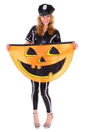 Young lady dressed in Halloween police costum carnaval, show emotions and hold pumpkin banner on white isolated background Stock Photo