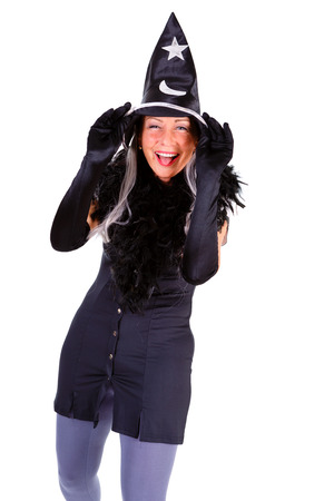 Smile Woman dressed in Halloween witch costum carnaval, show emotions of witch on white isolated background