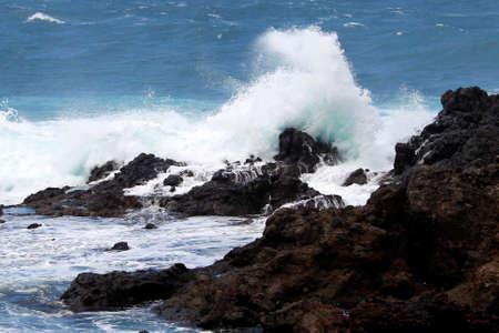 wild waves hitting on the rocks Stock Photo