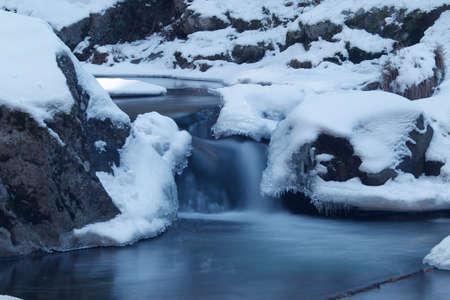view of a frozen river in the sierra de Madrid