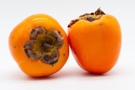 Orange persimmon on white background. Fruit native to South Korea and Japan.