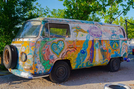 Madrid, Spain- April 17, 2021: DKV Volkswagen van decorated with hippie drawings. Hippies go. 1960s fashion