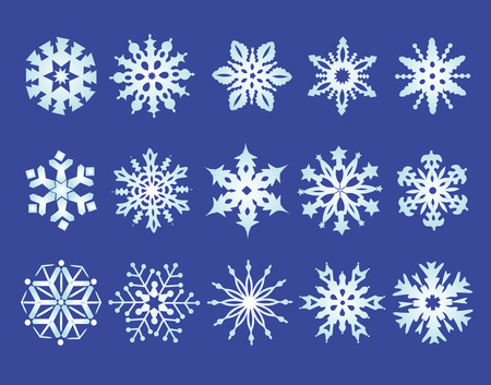 natal: Collection of colored snowflakes on blue background. Stock Photo