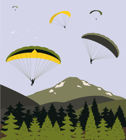 Paragliders over the mountains.