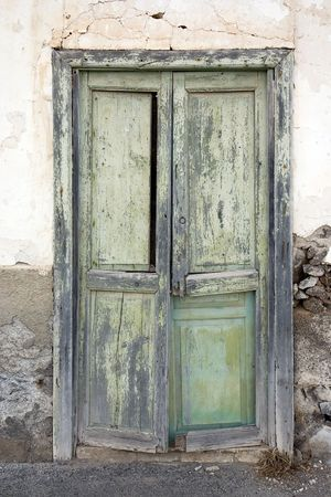 whitewashed: Weathered green door in a house in Haria, Lanzarote, Canary Islands, Spain