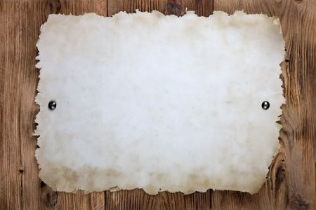 drawingpin: Old paper tacked to a wood wall Stock Photo