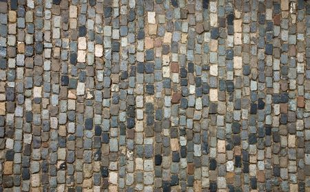 Traditional pavement; a street paved with cobblestone