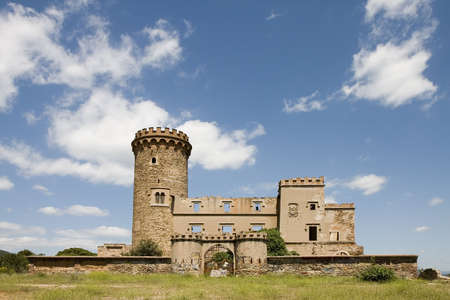 crenelation: Salvana tower in Santa Coloma de Cervello ( Baix Llobregat ), Barcelona province, Catalonia, Spain. Building constructed in XII century and transformed in XIX century. At the moment it is in ruins. Stock Photo