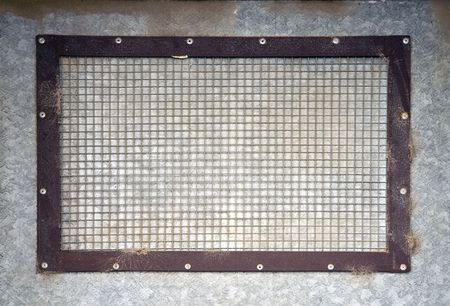 A weathered grid on a metal wall Stock Photo - 2356114