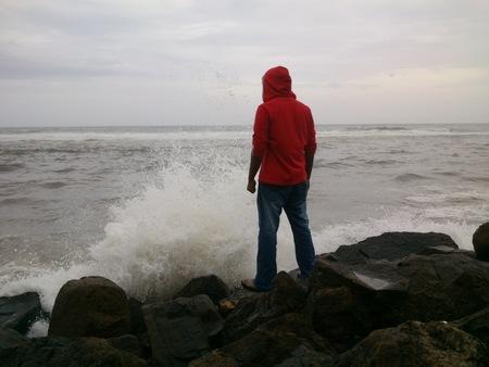 waves crashing: Giant waves crashing giant rocks and create cool water splash.