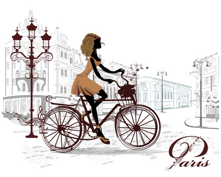 Fashion girl rides a bicycle, decorated with a musical stave and butterflies, the streets of the old town.
