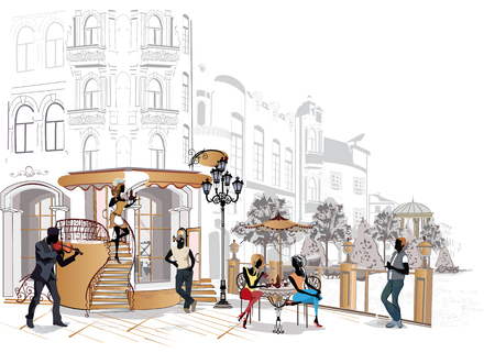 gente de la moda en el restaurante. Café de la calle con flores en la ciudad vieja. Los camareros sirven las mesas. Foto de archivo - 69143747