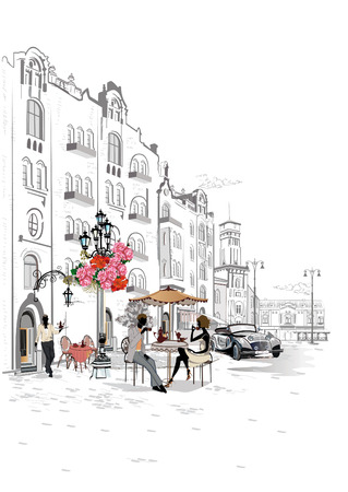 Fashion people in the street cafe. Street cafe with flowers in the old city. Waiters serve the tables.