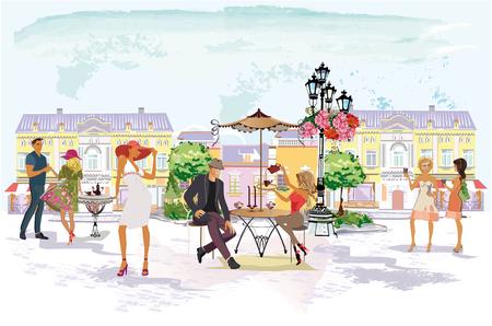 Modeleute im Straßencafé. Straßencafé mit Blumen in der Altstadt. Straßenmusikanten.