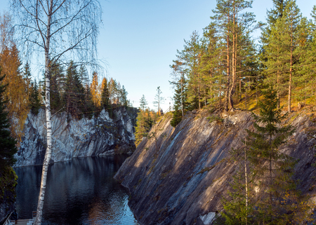 pit fall: Mountain Park Ruskeala - tourist complex, located in the Republic of Karelia Sortavala region. The basis of the complex is the object of cultural heritage, the history of the monument - filled with groundwater former marble quarry. Stock Photo