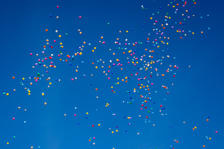 hundreds: Hundreds of colorful balloons are flying through the blue cloudless sky