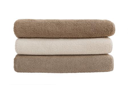 Three bath towels isolated over white Фото со стока