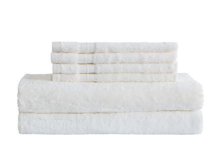 White bath towels in stack. Isolated over white